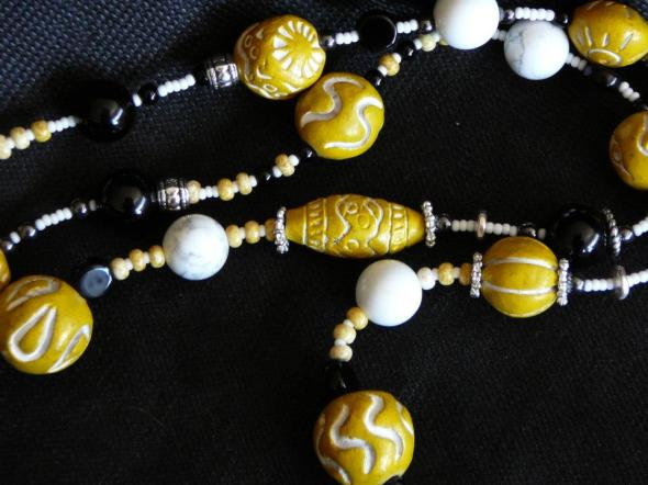 Carved black jade, yellow south African trading beads, onyx